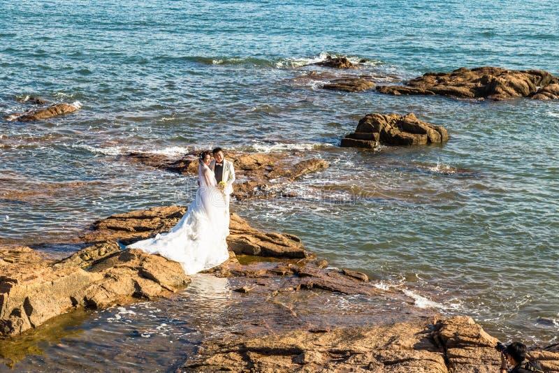 06-08-2016 - Qingdao, China - Chinese couple taking wedding photos, qingda royalty free stock photos