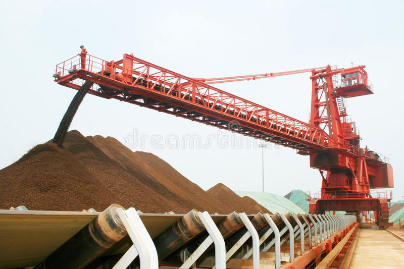 Qingdao port iron ore terminal. Beginning in 2000, as China's rapid economic development, the quality and quantity of production for iron ore in China can not royalty free stock photos