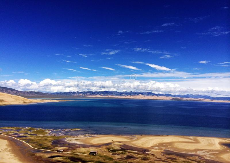 Qinghai Lake. Water and sky with a color, beautiful Qinghai Lake.The perfect combination of desert and lakes stock photography