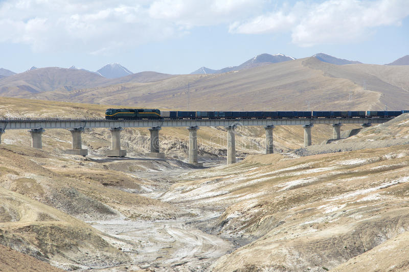Qinghai-Tibet railway. The landscape of Qinghai-Tibet railway bridge in Kunlun Mountain in Qinghai-Tibetan Plateau in China. This railway is the worlds highest stock image