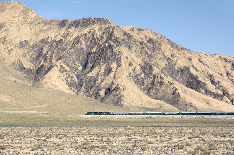 Qinghai-Tibet railway. The passenger train travel in Kunlun Mountain in Qinghai-Tibetan Plateau in China. This railway is the worlds highest altitude Railway stock photography