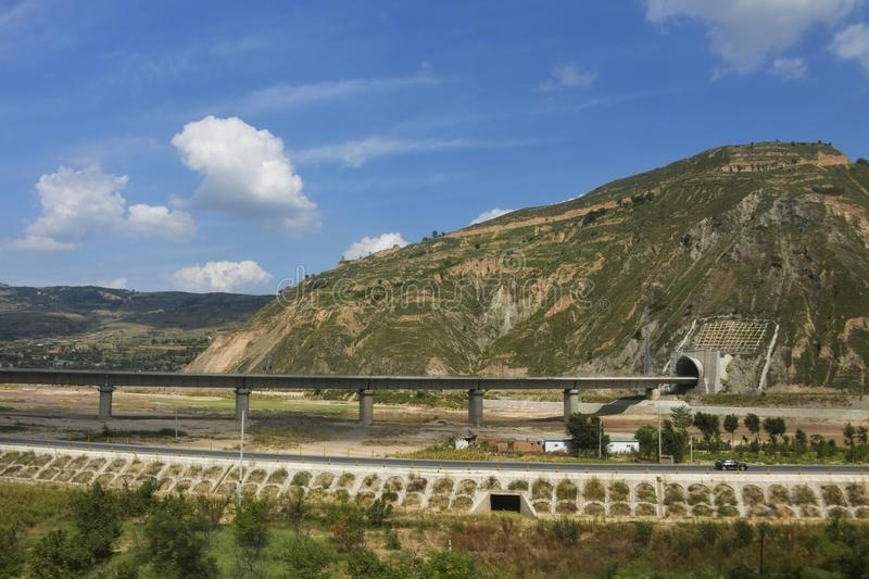 Qinling Mountains: scenery on the north south boundary of China. Pictured in Qinling Mountains, railways, highways, tunnels and bridges are built to ensure their stock images