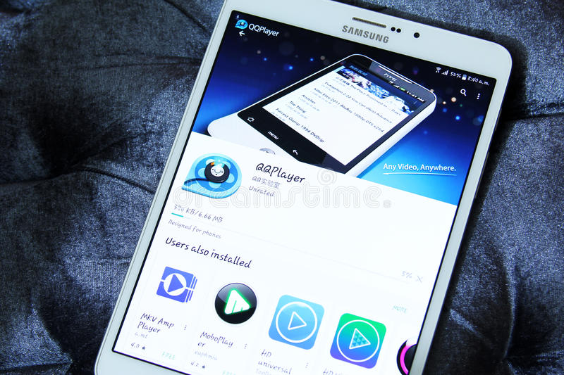 QQ Media Player app. Downloading QQ Media Player application from google play store on samsung tablet stock image