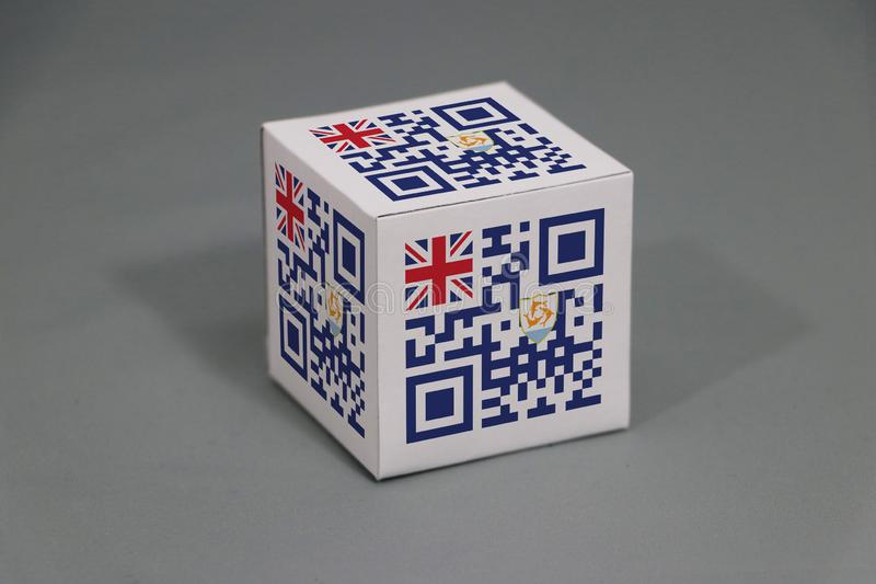 QR code set the color of Anguilla flag painted on the cubic. The concept of export trading from Anguilla. QR code set the color of Anguilla flag painted on the royalty free stock photos