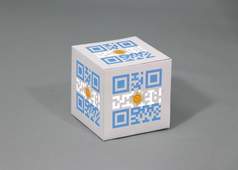 QR code set the color of Argentina flag painted on the cubic. The concept of export trading from Argentina. Paper box packaging for put products stock photography