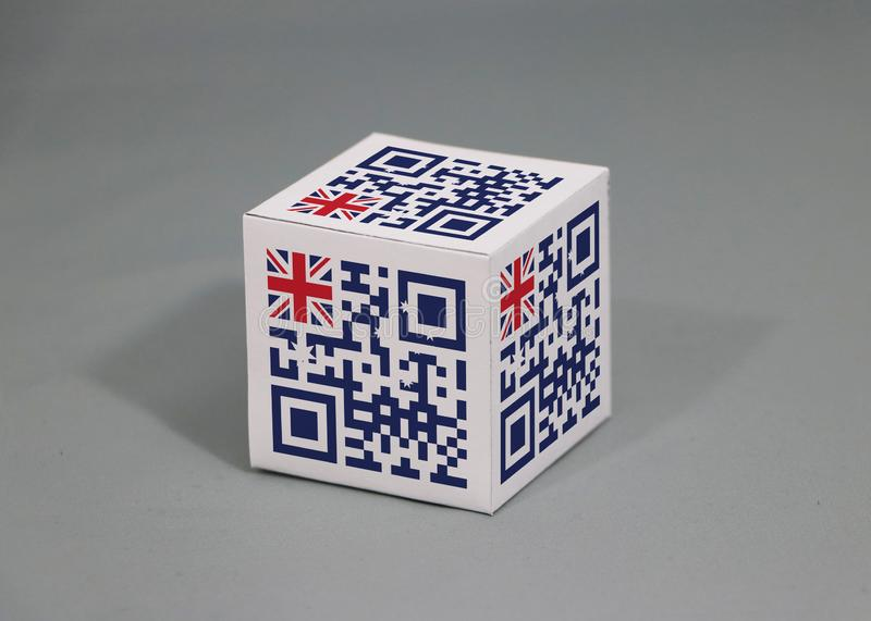QR code set the color of Australian flag painted on the cubic. The concept of export trading from Australia. QR code set the color of Australian flag painted on royalty free stock image