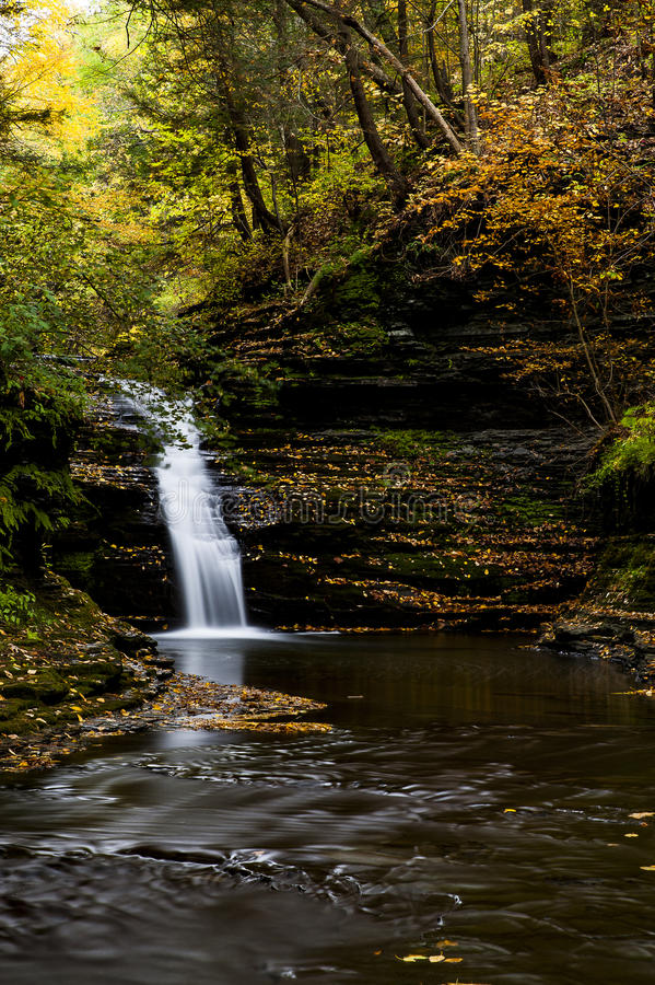 She-qua-ga Falls - Waterfall and Autumn / Fall Colors - New York. A scenic view of She-qua-ga Falls bathed in autumn / fall colors in New York royalty free stock images