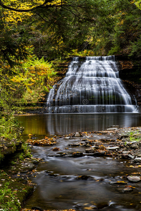 She-qua-ga Falls - Waterfall and Autumn / Fall Colors - New York. A scenic view of She-qua-ga Falls bathed in autumn / fall colors in New York royalty free stock photography
