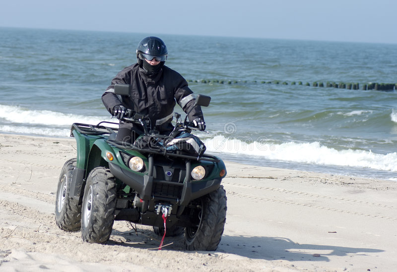 Download Quad on a beach (ATV) stock image. Image of driving, along - 4885097