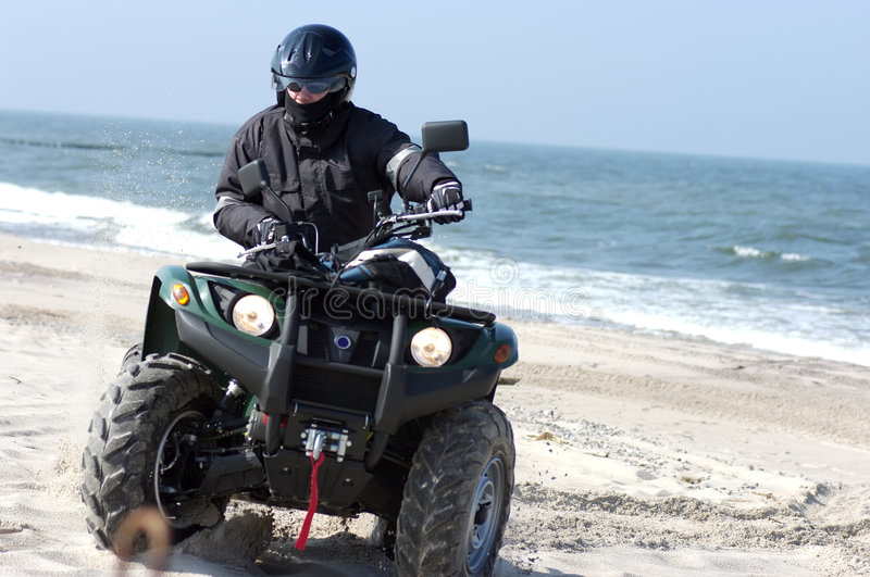 Quad On A Beach (ATV) Stock Images