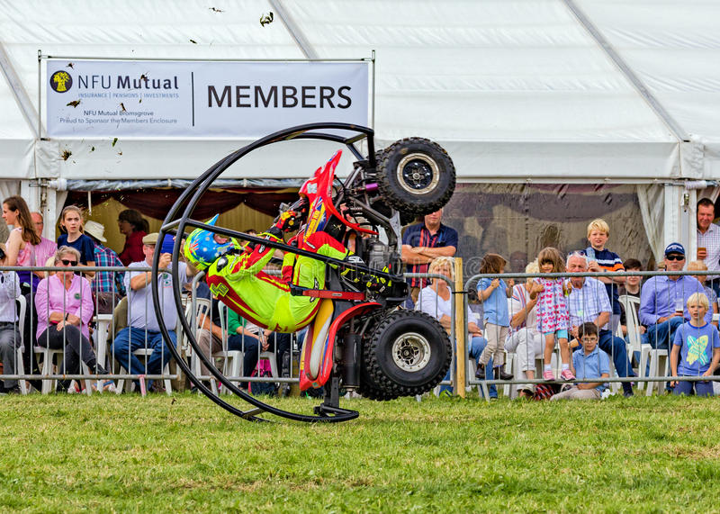 Quad bike rolling stunt. The Kangaroo Kid, Matt Coulter, completing a roll on his specially modified quad bike at the Hanbury Countryside Show in Worcestershire royalty free stock photos