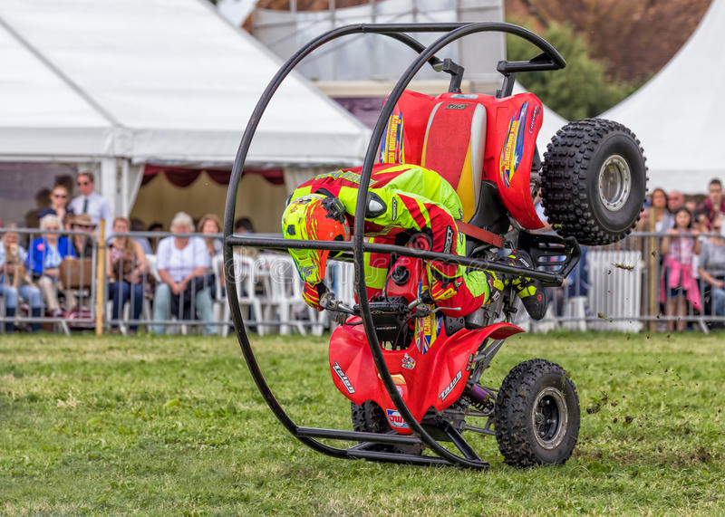 Quad bike rolling stunt. The Kangaroo Kid, Matt Coulter, rolling his specially modified quad bike at the Hanbury Countryside Show in Worcestershire royalty free stock photography