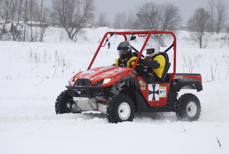 Download The Quad Bike's Drivers Ride Over Snow Track Editorial Image - Image: 13143210