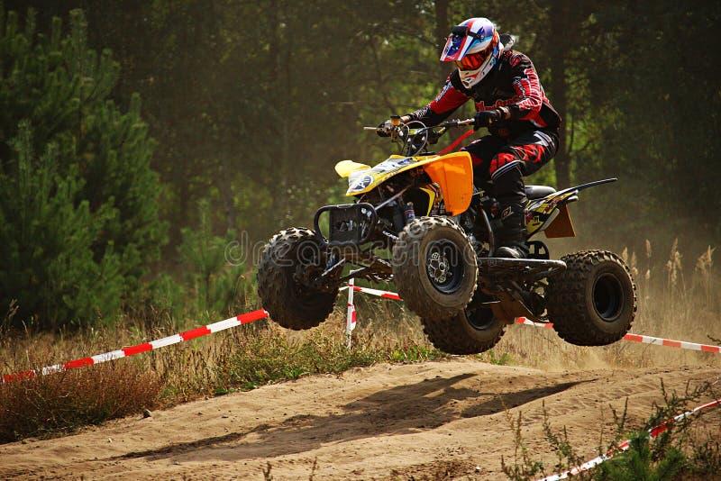 Quad bike taking off stock images