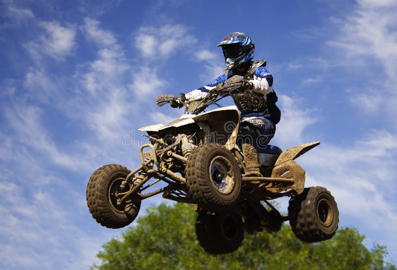 Quad blue jump. Jumping high with quad stock photo