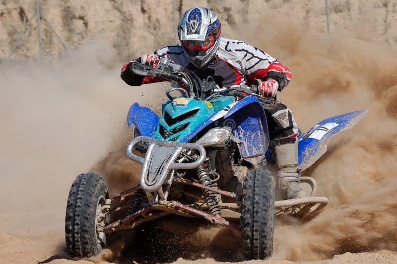 Quad III. Rider in a quad race stock image
