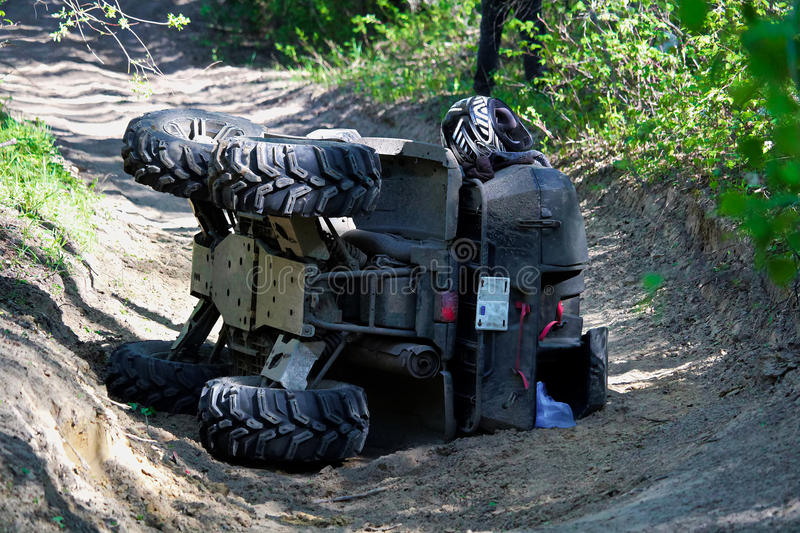 A quad on its side after it has been accidentally flipped stock image