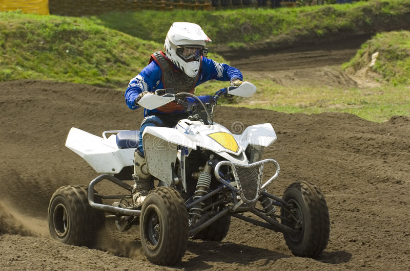 Quad race. Quadracing on a large motocross field at race event stock images