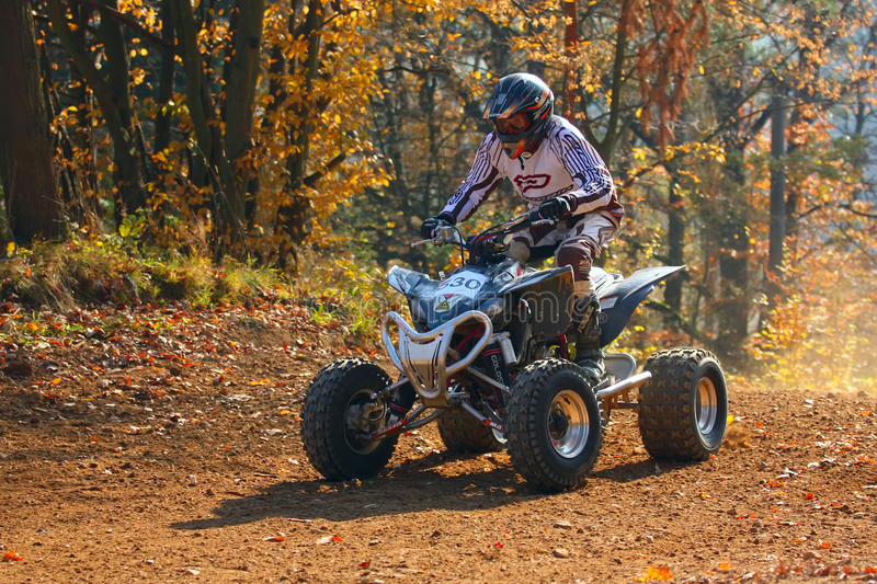 Quad racer. ZABREH, CZECH REPUBLIC - OCTOBER 30. Unidentified racer rides a quad motorbike in the Zabrezky Motocross on October 30, 2010 in the town of Zabreh stock images