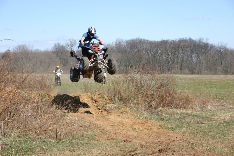 Quad rider stock images