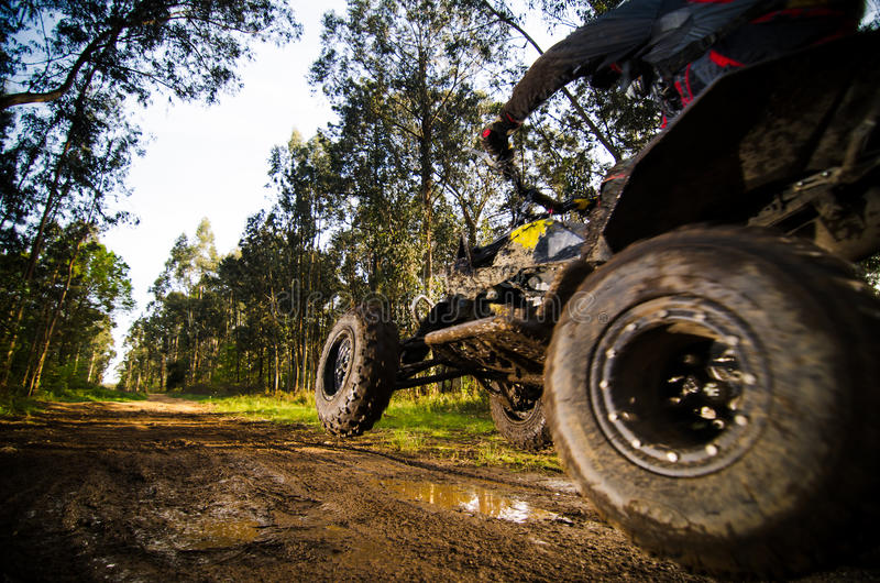 Quad rider jumping royalty free stock photography