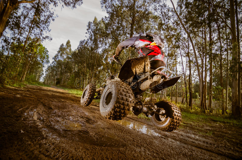 Quad rider jumping royalty free stock image