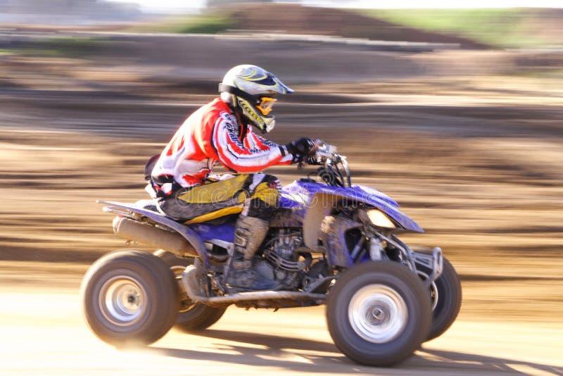 Quad speed. Quad bike speeding,background blurred royalty free stock photography