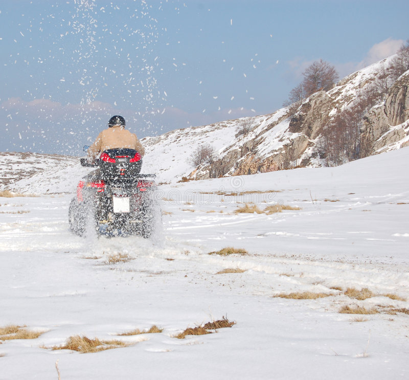 Download Quad Throwing Snow All Over Stock Image - Image of danger, landscape: 2544299