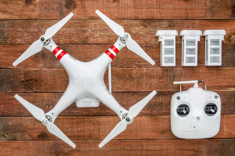 Quadcopter drome with a radio controller and spare batteries. Fort Collins, CO, USA - March 17, 2015: DJI Phantom 2 with a radio controller and spare LiPo stock photography
