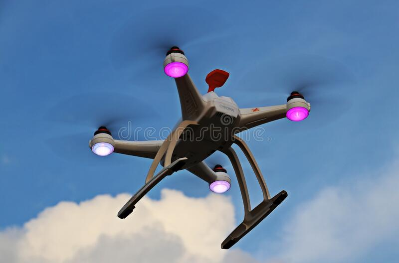 Quadcopter drone in flight royalty free stock photography