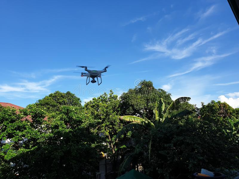 Drone hovering at 20 feet stock images