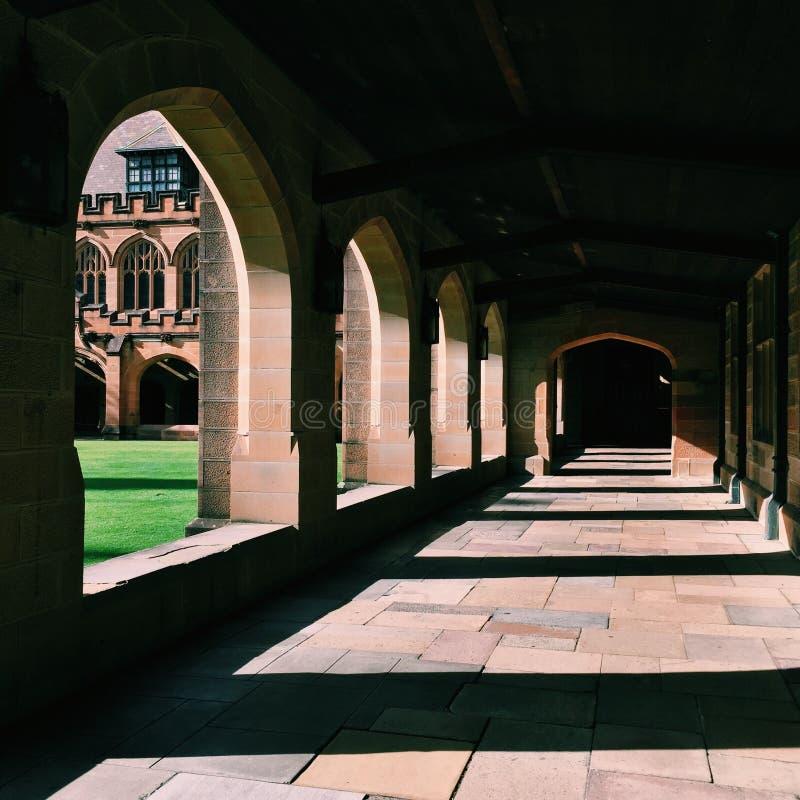 Quadrangle. A long corridor with the shadows of columns at quadrangle Sydney University stock photo