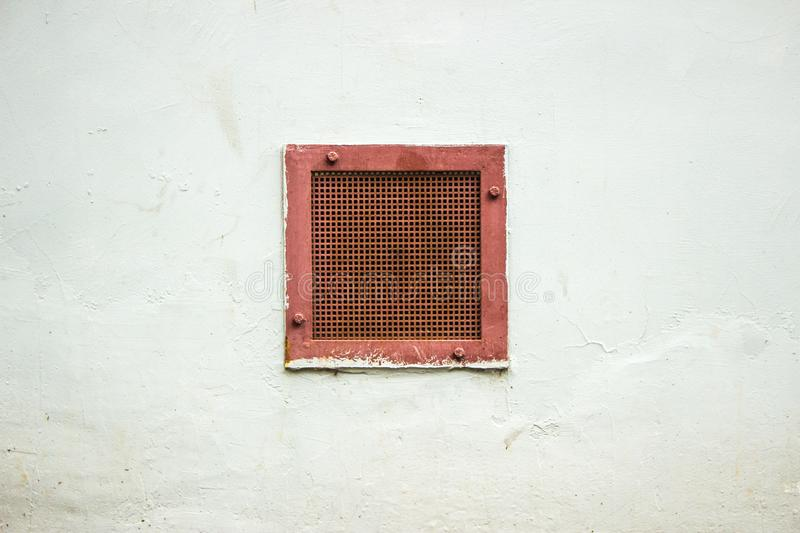 Quadrant holes for ventilation on a wall. Circulation of air in the room. grilles for ventilation. Holes in the wall for royalty free stock image