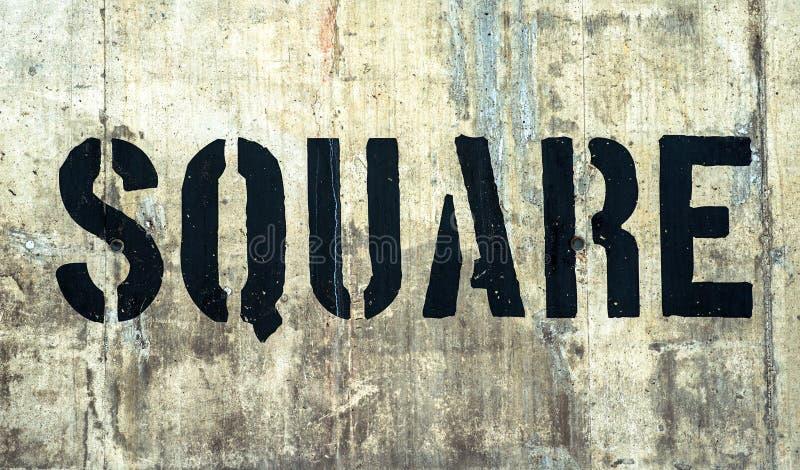Quadrat in den Schmutzschwarz-Graffitibuchstaben stockfotos