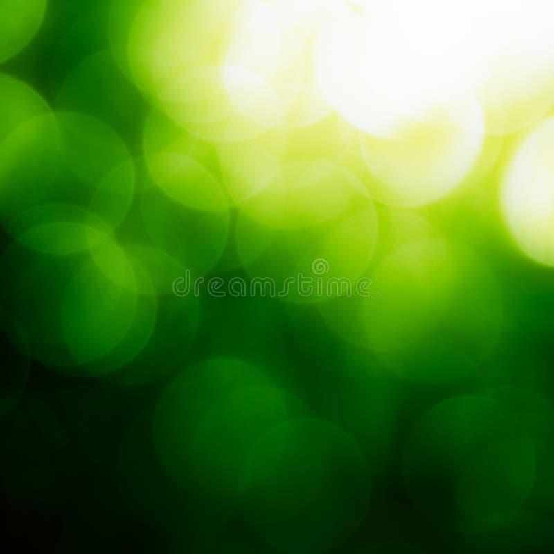 Quadratischer grüner Bokeh Hintergrund.
