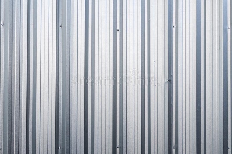 Quadrato di alluminio del metallo del fondo del primo piano dello zinco verticale immagine stock