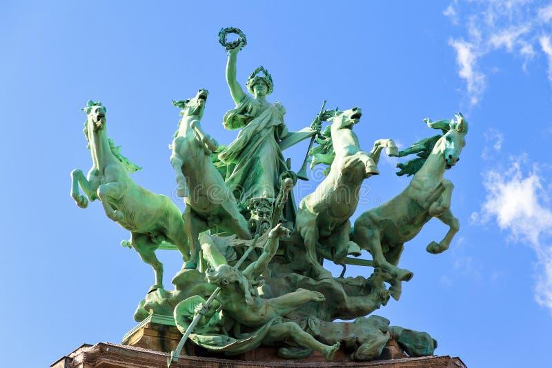 Quadriga statue Paris. Quadriga statue on top of the Grand Palais in Paris. L'Immortalite devancant le Temps stock photography