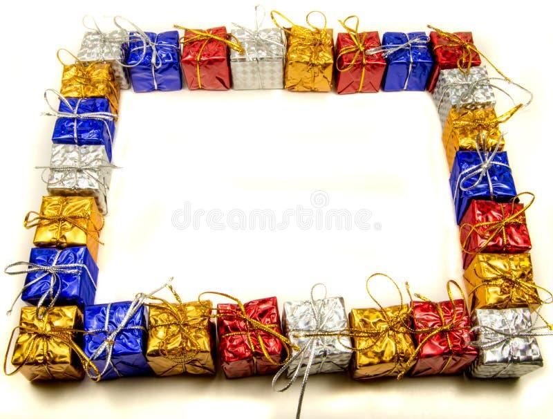 Quadro colorido dos presentes de Natal foto de stock