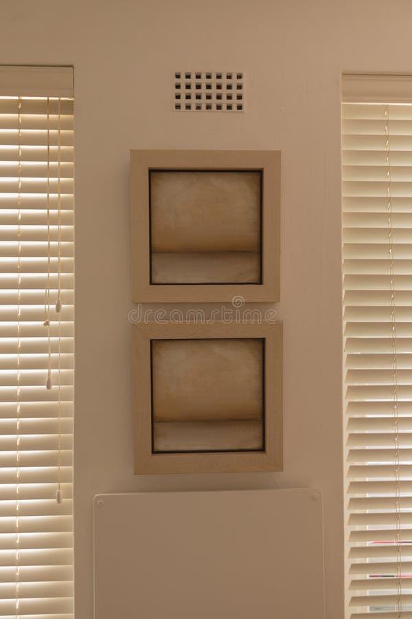 Quadro da parede entre cortinas de janela imagem de stock royalty free