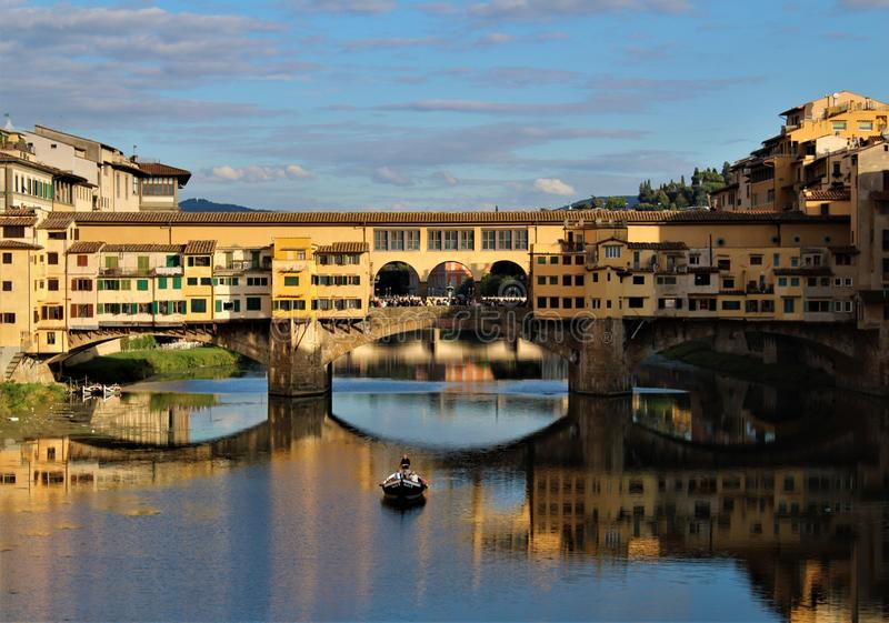 Quadro da Ponte Vecchio. The Ponte Vecchio is a medieval stone closed-spandrel segmental arch bridge over the Arno River, in Florence, Italy, noted for still royalty free stock images