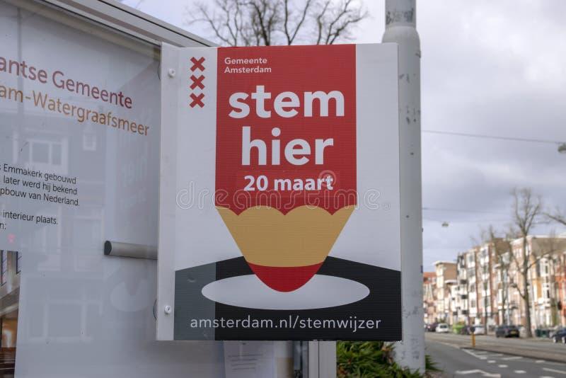 Quadro de avisos você pode votar aqui em Amsterdão os Países Baixos 2019 imagem de stock royalty free