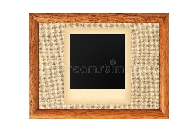 Quadro de madeira com a foto velha vazia isolada no branco foto de stock