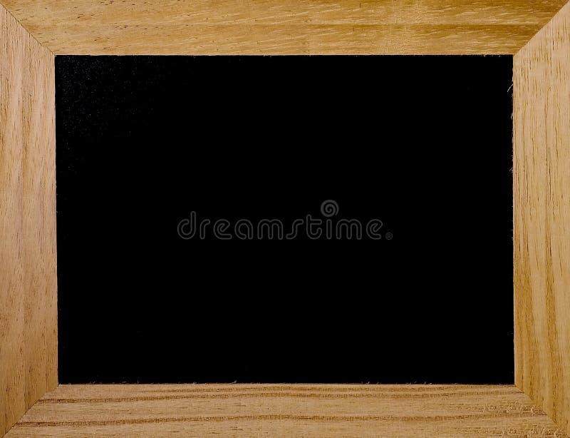 Quadro de madeira com o fundo preto do quadro-negro fotografia de stock royalty free