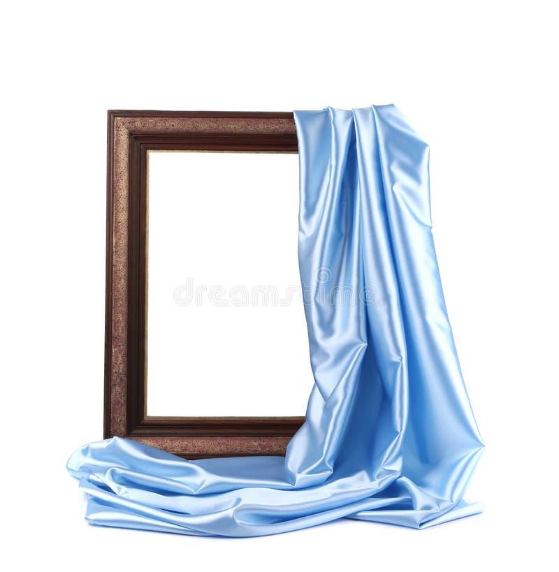 Quadro de madeira com seda azul. imagens de stock