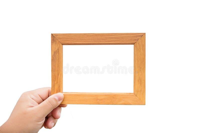 quadro de madeira da posse da mão no fundo branco a imagem para adiciona o texto e copia o espaço para o objeto fotografia de stock royalty free