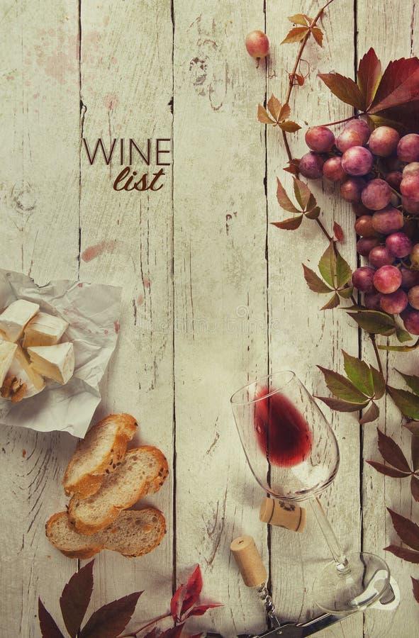 Quadro do alimento com vinho e uva fotos de stock