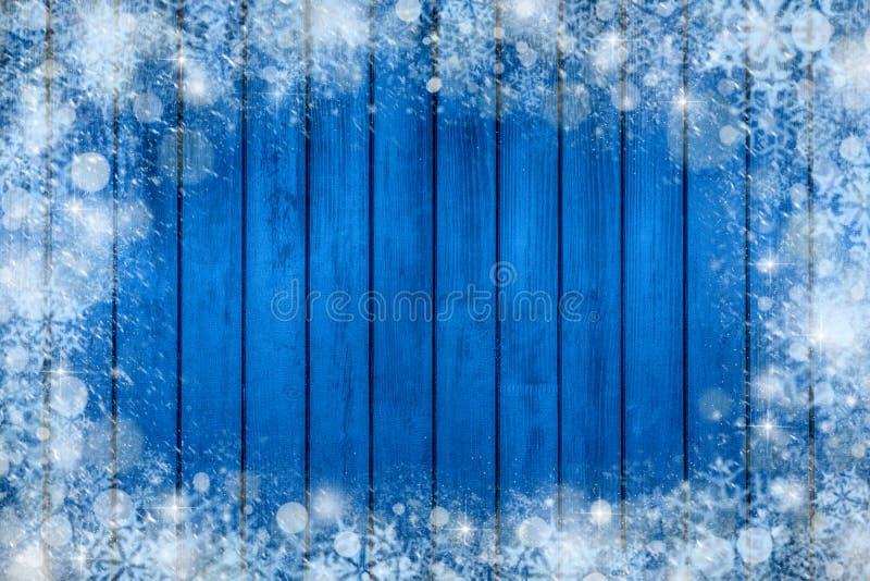 Quadro do fundo do Natal com neve e floco de neve decorações do ano novo no fundo de madeira azul ilustração stock