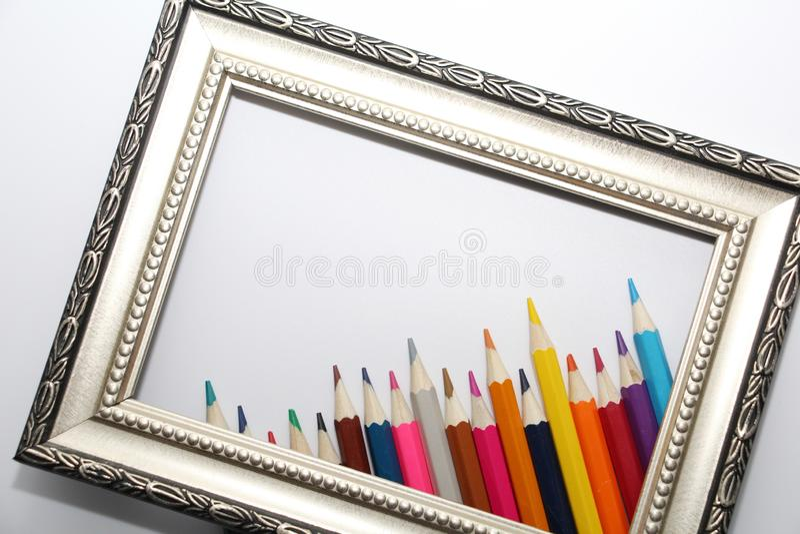Quadro do vintage para pinturas e lápis coloridos em um fundo branco foto de stock royalty free