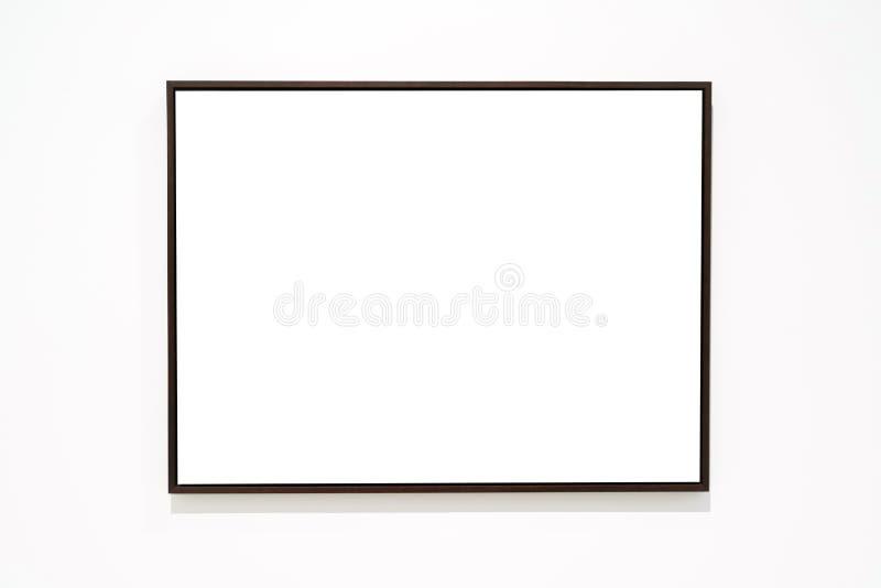 Quadro dourado vazio vazio no fundo branco Galeria de arte, museu foto de stock