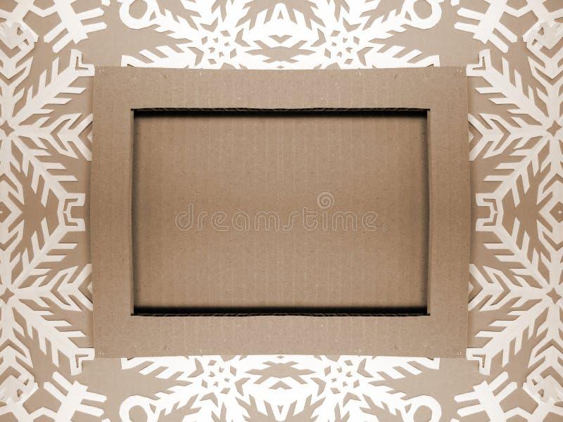 Quadro e flocos de neve Corte de papel imagem de stock
